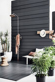 Outdoor shower on terrace with dark wooden planks