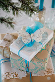 Christmas packaging with stamp motifs in blue and white