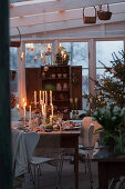 A view of Christmas table with burning candles