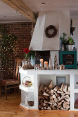 Christmas decorated rural kitchen with wood storage