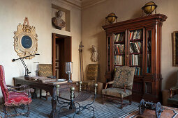 Oak furniture, antique chairs, desk, busts and globes in study
