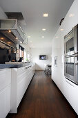 Elegant white kitchen with fitted appliances