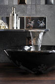 Sink with waterfall tap in designer bathroom
