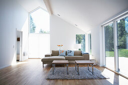 Sofa set and coffee table next to terrace doors in living room