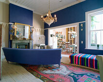 Blue couch in living room with blue accent walls
