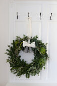A Christmas wreath with bells on a door