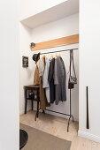 Clothes rack in niche in hallway