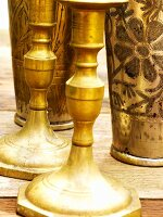 Brass candlesticks and beakers
