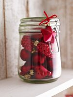 Christmas tree ornaments in storage jar