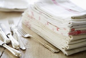 Silvery cutlery and tea towels