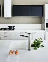 A kitchen with a sink and a gas hob