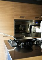 A gas hob in a modern fitted kitchen