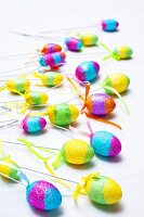 Coloured eggs on sticks (Easter decorations)