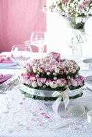 Arrangement of roses on cake stand