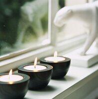 Tealight holders on windowsill