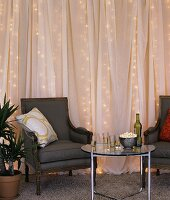 Room decorated for a party with fairy lights