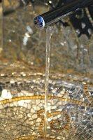 Water running down a mossaic wash basin