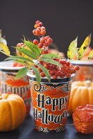 Paper cup with rowan berries (Halloween)