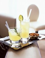 Lemon and pineapple cocktails with rum and nuts
