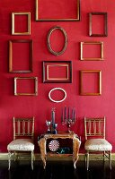 Assorted Frames on a Wall; Chairs and Table