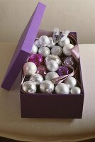 A box of silver Christmas baubles