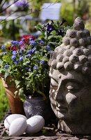 A Buddha head as a garden ornament