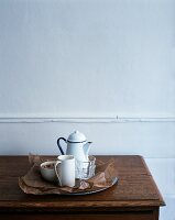 Glasses, a jug and a bowl on a tray