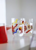 Close up of patterned glasses on dining room table.