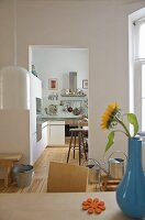 View from dining room into modern kitchen