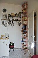 Shelving in corner of modern kitchen