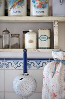 Old-fashioned storage jars on a shelf