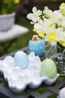 Decorated eggs in a ceramic egg tray