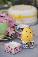 Decorated egg in porcelain holders