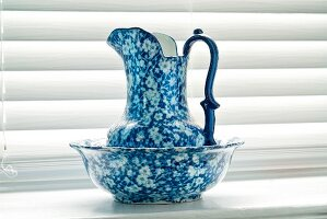 Blue and White Antique Wash Bowl on a Window Sill