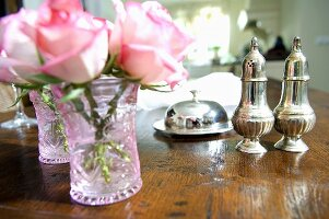Still life with flowers, salt and pepper shakers