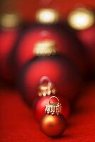 Assorted Christmas baubles in shades of red