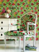 Floral wallpaper and chair upholstered in matching fabric