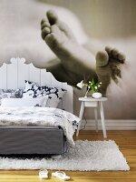 Photo wallpaper of baby's feet in bedroom