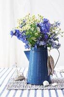 Wild flowers in enamel coffee pot