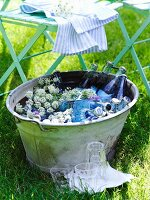 Drinks cooling in zinc tub with flowers