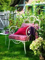 Metal armchair and side table in garden