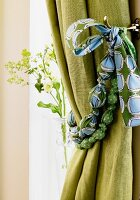 Hand-crafted curtain tie-back made from marbles and scraps of fabric