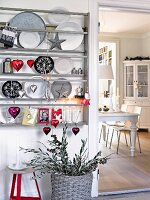 A plate rack decorated for Christmas