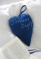 Heart-shaped, scented sachet made from blue fabric