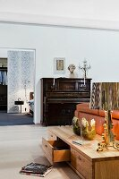 Living room with low sideboard and piano