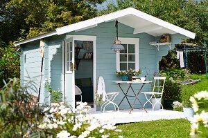 Light blue, wooden, Scandinavian-style summer house