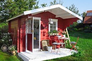 Red, wooden, Scandinavian-style summer house