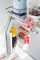 Open fridge in Scandinavian summer house