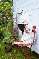Outdoor sink & folding chair outside Scandinavian summer house