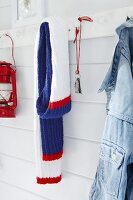 A knitted scarf hanging on a hook